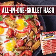 All in one skillet hash for breakfast featuring potatoes, onion, tomatoes, eggs and Indiana Kitchen bacon