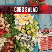 hearty easy and very filling cobb salad featuring indiana kitchen bacon and ham plus chicken hardboiled eggs onion avocado tomatoes lettuce blue cheese and more
